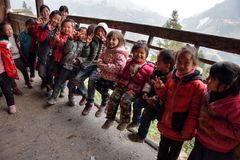 GUIZHOU PROVINCE, CHINA – CIRCA DECEMBER 2017: A group of kids high in the mountain of Guizhou province. stock images