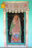 GUJARAT, INDIA - DECEMBER 20, 2013: Tribal woman at the entrance of her house (Bhunga) in a local village near Bhuj. Tribal woman at the entrance of her house ( stock photography