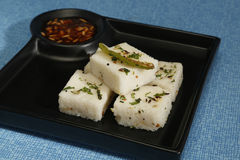 Gujarati Khaman White Dhokla or Steamed Flour Snack - Indian Foo Royalty Free Stock Image