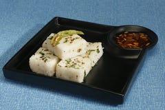 Gujarati Khaman White Dhokla or Steamed Flour Snack - Indian Foo Royalty Free Stock Photo