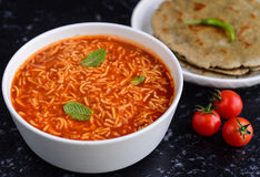 Gujarati main course Indian meal. Gujarati meal in India- sev tomato nu shak made with bengal gram flour fried noodles or sev and tomato gravy served with Bhakri royalty free stock photography