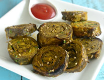 Gujarati Snack Patra. Made up of colocasia leaves and gram flour stock images
