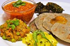 Gujarati Thali. Consisting of Bajra roti,Brinjal,Tomato Sev,Sambhada and jaggery stock photography