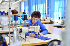 GUKOVO, RUSSIA - SEPTEMBER, 2016: Workers work in a garment Stock Photos