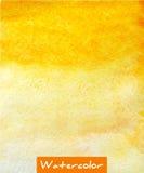 Gul abstrakt bakgrund för vattenfärghandattraktion Arkivfoto