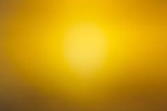 Gul abstrakt suddig bakgrund Royaltyfria Foton