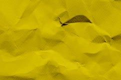 Gul bakgrund och tapet vid skrynklig pappers- textur och fr arkivbild