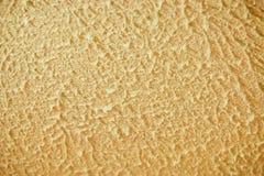 Gul dekorativ murbrukbakgrund Royaltyfria Foton
