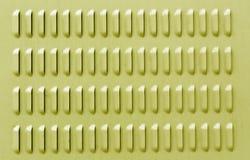 Gul färgmetallyttersida med ventilationshål Royaltyfri Foto