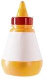 Gul flaska av lim med den tomma etiketten royaltyfri foto