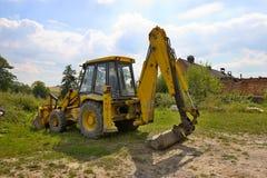 gul grävare Arkivfoto