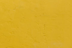 gul grunge cementerar väggen Arkivfoto