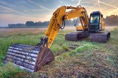 Gul grävskopa Arkivfoto
