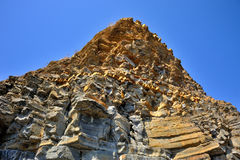 Gul klippa av sandsten Arkivfoton