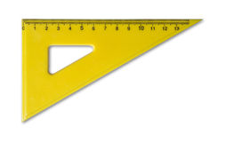 Gul linjal för matematik och geometri i skola royaltyfria foton