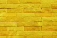 Gul målad textur för tegelstenvägg för bakgrunds- och designkonstarbete arkivbild