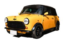 Gul mini- tunnbindare, europeisk bil royaltyfri fotografi