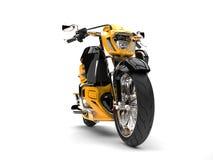 Gul modern avbrytarmotorcykel för sol - framhjulcloseupskott Royaltyfri Bild