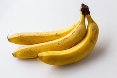 Gul mogen banan på en vit bakgrund Fotografering för Bildbyråer
