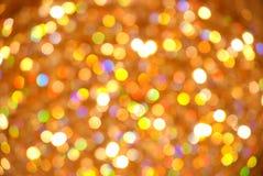 Gul och orange bokehbakgrund Gul bokeh från naturligt Bakgrund för julljus Glödande bakgrund för ferie Defocused B royaltyfria foton