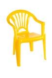 Gul plastic stol Arkivfoto