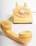 Gul roterande telefon Fotografering för Bildbyråer