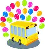 Gul skolbuss och ballonger Arkivbilder