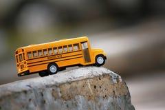 Gul skolbussleksakmodell Fotografering för Bildbyråer