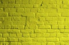 Gul tegelstenbakgrund Arkivfoto
