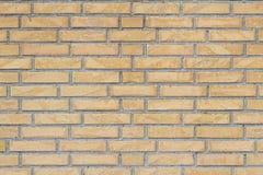 Gul tegelstenvägg för textur eller bakgrund som är horisontal Royaltyfria Bilder