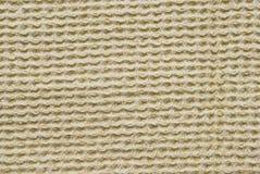 Gul tygbakgrund eller textur Royaltyfria Bilder