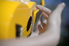 Gul ukulele Royaltyfri Foto