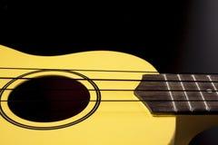 Gul ukulele royaltyfria bilder
