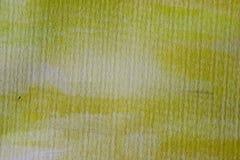 Gul vattenfärgbakgrund på texturerat papper Gul abstrakt vattenfärgtextur och bakgrund för design Arkivfoton