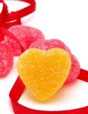 Gula hjärtagodisar Arkivfoto