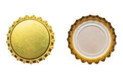 Gula kapsyler som isoleras på vit Fotografering för Bildbyråer