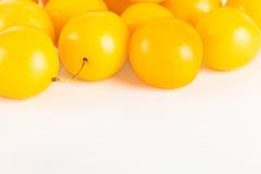 Gula körsbärsröda plommoner Arkivbild