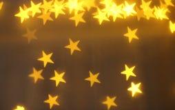 Gula ljus, gula stjärnor, liten stjärna, liten stjärna, ljus effekt Arkivbilder
