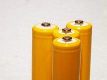 Gula omladdningsbara batterier Arkivfoto