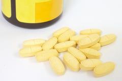 Gula preventivpillerar Arkivbild