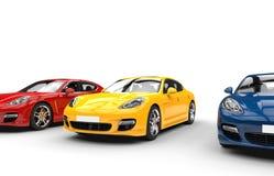 Gula röda och blåa snabba bilar Fotografering för Bildbyråer
