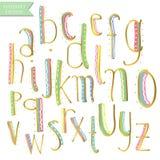 Gula rosa blåa för färgpulveralfabet för grön guld färgrika bokstäver Fotografering för Bildbyråer
