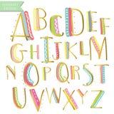 Gula rosa blåa för färgpulveralfabet för grön guld färgrika bokstäver Hand D Arkivfoton