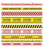 Gula varningsband med texter Royaltyfri Fotografi