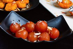 Gulab Jamun Pune, India. Bowl filled with fresh Gulab Jamun Pune, India royalty free stock photography