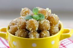 Gulab jamun in yellow bowl Royalty Free Stock Images