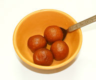 Gulab Jamun-yummy Indian sweetmeat. Yummy and mouth watering Indian sweetmeat,Gulab Jamun, served in a bowl with spoon Royalty Free Stock Photo