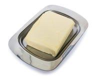 Gulaktigt smör i bestick för smör fotografering för bildbyråer