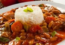 Gulasch mit Reis Stockbild