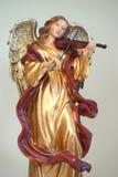 Guld- änglalik musiker royaltyfri fotografi